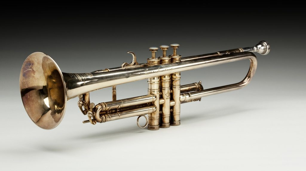 "Brass trumpet owned by Louis Armstrong, signed ""Henri Selmer Paris DŽposŽ Grands Prix GenŽve 1927 Liege 1930 H. Selmer 4 Place Dancourt PARIS Made in France"" ""Louis Armstrong"" Mouthpiece engraved: ""Mt. Vernon N.Y. 7E VINCE""; Object Number Trumpet TR2008-32.1; mouthpiece TR2008-32.2"